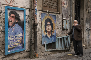 People are seen outside San Paolo stadium after the announcement of the Argentine soccer legend Diego Armando Maradona death in Naples, Italy on November 26, 2020.