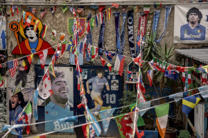 A big picture of the Argentine soccer legend Diego Armando Maradona is seen on the main facade of the Royal Palace after the announcement of his death in Naples, Italy on November 26, 2020.