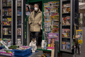 People are seen near carves, football shirts and pictures of the Argentine soccer legend Diego Armando Maradona are seen outside San Paolo stadium after the announcement of his death in Naples, Italy on November 27, 2020.