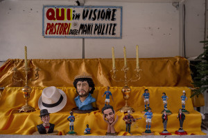 Children are seen near scarves, football shirts and pictures of the Argentine soccer legend Diego Armando Maradona are seen outside San Paolo stadium after the announcement of his death in Naples, Italy on November 27, 2020.