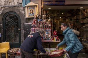 Scarves, football shirts and pictures of the Argentine soccer legend Diego Armando Maradona are seen outside San Paolo stadium after the announcement of his death in Naples, Italy on November 27, 2020.