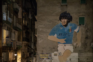 A mural depicting the Argentine soccer legend Diego Armando Maradona is seen in the Spanish Quarter after the announcement of his death in Naples, Italy on November 25, 2020.