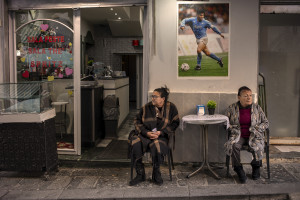 Pictures and football shirts of the Argentine soccer legend Diego Armando Maradona are seen in the Spanish Quarter after the announcement of his death, in Naples, Italy on November 27, 2020.
