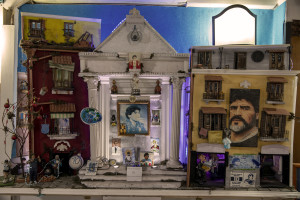 A man is seen near an altar dedicated to the Argentine soccer legend Diego Armando Maradona is seen in the Spanish Quarter after the announcement of his death, in Naples, Italy on November 27, 2020.
