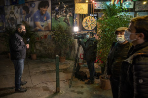A foreign TV crew at work in the Spanish Quarter after the announcement of the Argentine soccer legend Diego Armando Maradona death, in Naples, Italy on November 27, 2020.