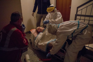 Maria, 87 years old and suspected covid-19 positive has a respiratory crisis before being transferred to the hospital after an emergency call to the Italian Red Cross for experiencing respiratory problems in Villa di Serio, province of Bergamo, Northern Italy on April 12, 2020.