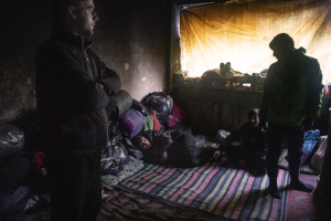 Migrants are seen inside an abandoned factory in Bihac, Bosnia and Herzegovina on January 22, 2021. Lots of migrants avoid staying inside the Bosnian official refugee camps because of the hard conditions in which they are forced to live and also because the people hosted in the official camps  cannot go out freely.