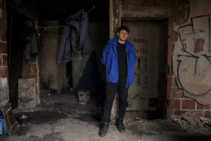 A migrant is seen inside an abandoned building in Bihac, Bosnia and Herzegovina on January 22, 2021. Lots of migrants avoid staying inside the Bosnian official refugee camps because of the hard conditions in which they are forced to live and also because the people hosted in the official camps  cannot go out freely.
