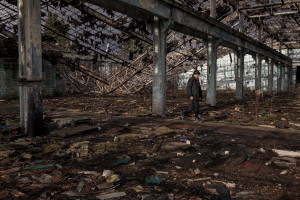 A migrant walks among the rubble of an abandoned factory in Bihac, Bosnia and Herzegovina on January 23, 2021. Lots of migrants avoid staying inside the Bosnian official refugee camps because of the hard conditions in which they are forced to live and also because the people hosted in the official camps  cannot go out freely.