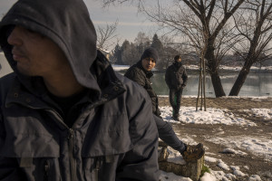 Migrants are seen outside an abandoned building in Bihac, Bosnia and Herzegovina on January 27, 2021. Lots of migrants avoid staying inside the Bosnian official refugee camps because of the hard conditions in which they are forced to live and also because the people hosted in the official camps  cannot go out freely.