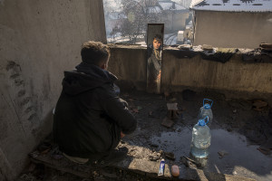 A migrant is portrayed through a mirror inside an abandoned building in Bihac, Bosnia and Herzegovina on January 27, 2021. Lots of migrants avoid staying inside the Bosnian official refugee camps because of the hard conditions in which they are forced to live and also because the people hosted in the official camps  cannot go out freely.