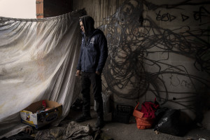 Milad, 28 years old from Iran is portrayed inside an abandoned bulding in Bihac, Bosnia and Herzegovina on January 21, 2021. After leaving his country due to political problems, he lived in Serbia for a year. He has been in Bosnia for a week. Lots of migrants avoid staying inside the Bosnian official refugee camps because of the hard conditions in which they are forced to live and also because the people hosted in the official camps  cannot go out freely.