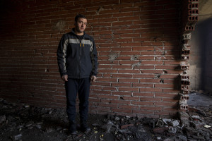 Nekib, 16 years old from Afghanistan is portrayed inside an abandoned building in Bihac, Bosnia and Herzegovina on January 22, 2021. Lots of migrants avoid staying inside the Bosnian official refugee camps because of the hard conditions in which they are forced to live and also because the people hosted in the official camps  cannot go out freely.
