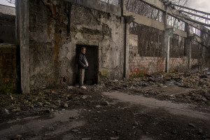 A Pakistani migrant is seen inside an abandoned factory in Bihac, Bosnia and Herzegovina on January 22, 2021. Lots of migrants avoid staying inside the Bosnian official refugee camps because of the hard conditions in which they are forced to live and also because the people hosted in the official camps  cannot go out freely.