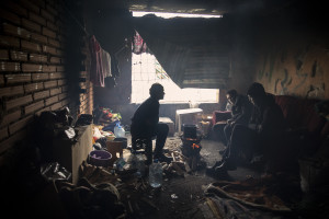 Migrants are seen inside an abandoned building in Bihac, Bosnia and Herzegovina on January 22, 2021. Lots of migrants avoid staying inside the Bosnian official refugee camps because of the hard conditions in which they are forced to live and also because the people hosted in the official camps  cannot go out freely.