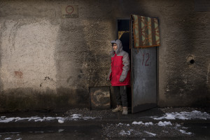 A migrant is seen outside an abandoned factory in Bihac, Bosnia and Herzegovina on January 26, 2021. Lots of migrants avoid staying inside the Bosnian official refugee camps because of the hard conditions in which they are forced to live and also because the people hosted in the official camps  cannot go out freely.