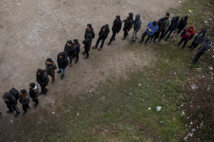 Migrants lined up during the food distribution outside an abandoned building in Bihac, Bosnia and Herzegovina on January 21, 2021. Lots of migrants avoid staying inside the Bosnian official refugee camps because of the hard conditions in which they are forced to live and also because the people hosted in the official camps  cannot go out freely.