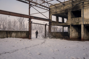 A migrant crosses the snow-covered fields near an abandoned factory in Bihac, Bosnia and Herzegovina on January 26, 2021. Lots of migrants avoid staying inside the Bosnian official refugee camps because of the hard conditions in which they are forced to live and also because the people hosted in the official camps  cannot go out freely.