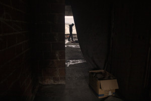 A migrant is seen inside an abandoned building in Bihac, Bosnia and Herzegovina on January 21, 2021. Lots of migrants avoid staying inside the Bosnian official refugee camps because of the hard conditions in which they are forced to live and also because the people hosted in the official camps  cannot go out freely.