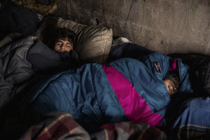 Migrants sleep inside an abandoned building in Bihac, Bosnia and Herzegovina on January 22, 2021. Lots of migrants avoid staying inside the Bosnian official refugee camps because of the hard conditions in which they are forced to live and also because the people hosted in the official camps  cannot go out freely.