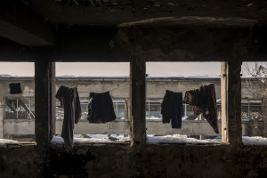 Clothes hanging out to dry inside an abandoned factory in Bihac, Bosnia and Herzegovina on January 26, 2021. Lots of migrants avoid staying inside the Bosnian official refugee camps because of the hard conditions in which they are forced to live and also because the people hosted in the official camps  cannot go out freely.