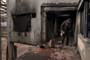 A migrant is seen inside an abandoned factory in Bihac, Bosnia and Herzegovina on January 23, 2021. Lots of migrants avoid staying inside the Bosnian official refugee camps because of the hard conditions in which they are forced to live and also because the people hosted in the official camps  cannot go out freely.